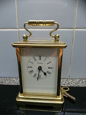 old Brass Cased Carriage Clock working with key.. 8 Day white dial