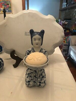 Porcelain white and blue asian lady kneeling