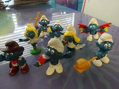 Vintage lot of 8 Smurf figures.