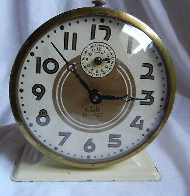 SALUTE made by Ingraham Co. Keeps Good Time Alarm works Gold & white Face