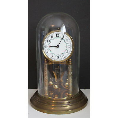 An Early C20th German Brass Anniversary Clock under Glass Dome