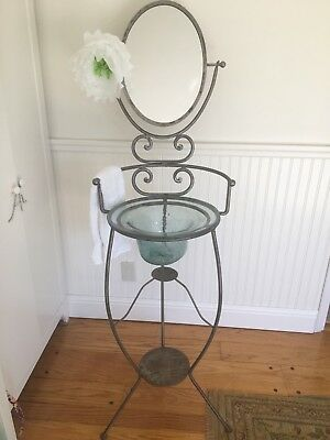 Vintage glass wash basin with mirror on iron stand