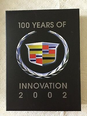 Cadillac 100 years of Innovation (2002), Framed Badge Crest Pin Set. NEW in BOX