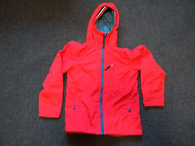 Next unisex raincoat in red, age 9 years.