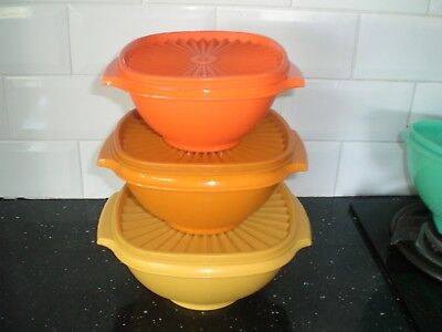 Tupperware servalier bowls and lids.