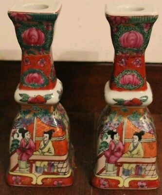 A pair of vintage, porcelain oriental candle holders.