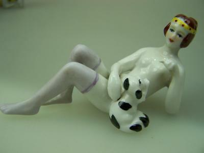 Bathing beauty with puppy Art Deco porcelain figurine