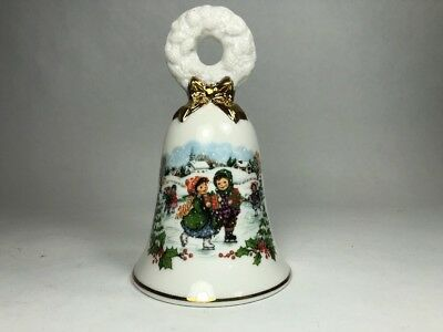 1986 Avon White Porcelain Christmas Bell Ice Skating Children with Gold Trim