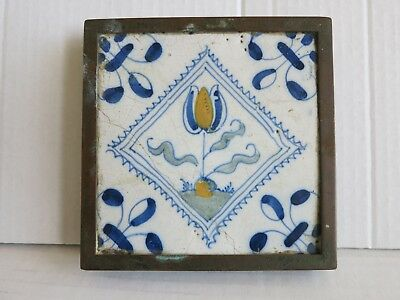 18th dutch delft polychrome tile in later plated brass frame and legs