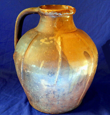 Large 18th century French museum quality glazed redware pitcher circa 1780