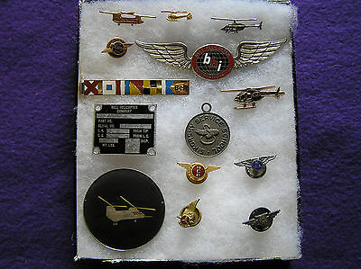 #230.  A mixed assortment of Ten (10) Bell & Sikorsky Helicopter insignia.