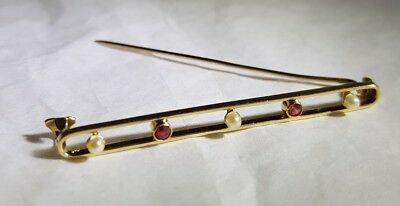 A Victorian 18ct Yellow Gold bar brooch/ tie pin. Set with seed pearls & Rubies