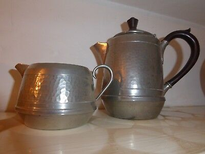 Old fashioned tin teapot and jug