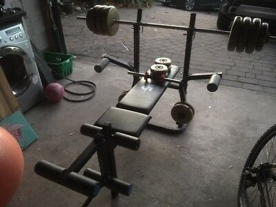 York 6605 Weight lifting bench and collection of weights