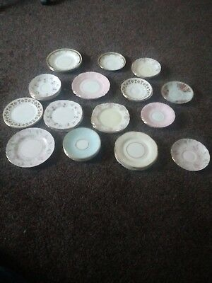A collection of saucers and side plates of different makes and sizes