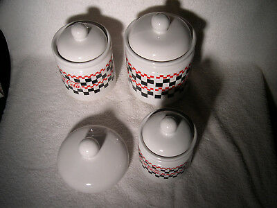 3 round Coca-Cola canistors by Gibson, 1997, checkerboard pattern