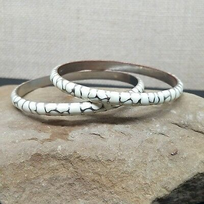 Pair Of White Enamel And Silver Tone Abstract Pattern Bangle Bracelets