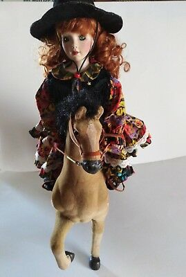 Porcelin doll with large horse.