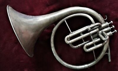 French horn. The PROFESSIONAL. DOES HAVE  one DENT. Come with mouthpiece