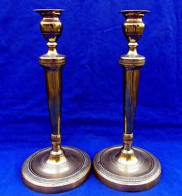 Superb large pair of formal French bronze Empire period candlesticks circa 1790