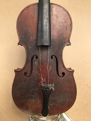 Old French violin with painting on back