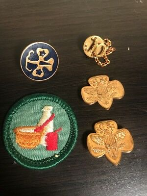 Lot of four vintage 1970s Girl Scouts pins and one Vintage Girl Scouts Patch GSA