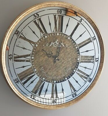 Beautiful mirrored antique gold finished glass round wall clock.