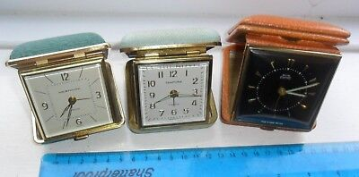 Three vintage bedside retro alarm clocks fold a way Westclox smith empire etc