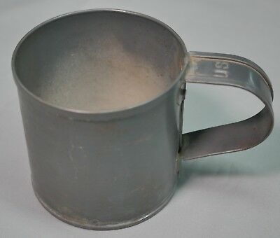 An original 1885 Army cup with U.S. stamped in the handle
