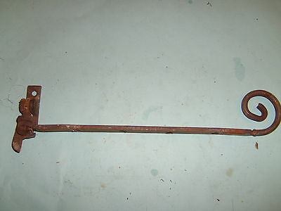 Reclaimed cast iron curly ended window stay-art deco?