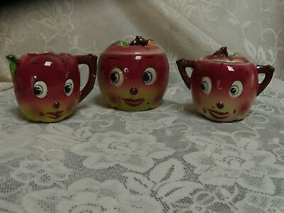 antique Anthropomorphic apple face creamer, sugar and biscuit or cookie jar cute