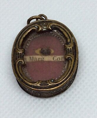 "Relic ""st. Marg. Margaret Mary Cor""  Ornate Brass Case Pendant"