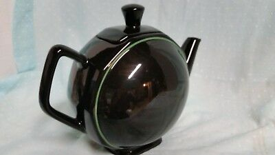 Elegant black porcelain teapot with lid from France holds 6 cups of liquid~~