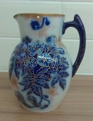 W&R Stoke On Trent 7 inch high Florida pattern jug with Gold highlighting