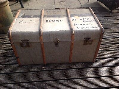 Old vintage antique large trunk suitcase in used condition