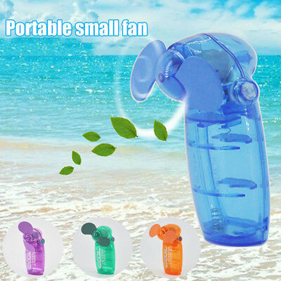 Cooler Travel Holiday Portable Pocket Fan Battery Mini Cool Air Hand Held Blower