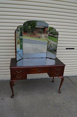 dressing table with mirrors and drawers