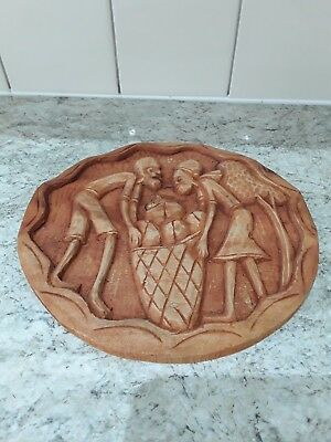 vintage ethnic hand carved wooden wall plaque...26cm in diameter
