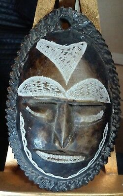 Vintage Papua New Guinea carved stone mask like necklace piece or? Oceanic