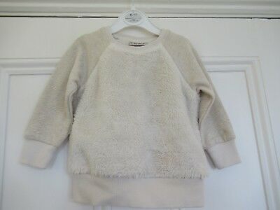12-18m: Soft furry ivory sweatshirt/top: Glittery sleeves: NEXT: Good condition