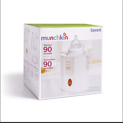Munchkin Baby bottle warmer with instruction Book