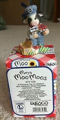 Mary's Moo Moos Lionel A Treasure for a Lifetime boy holding train figurine 6711