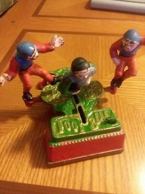 Vintage cast iron mechanical  3 player toy football bank