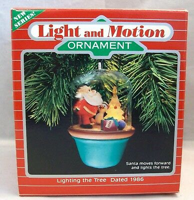 Hallmark Light and Motion Ornament Lighting the Tree Santa lights the tree