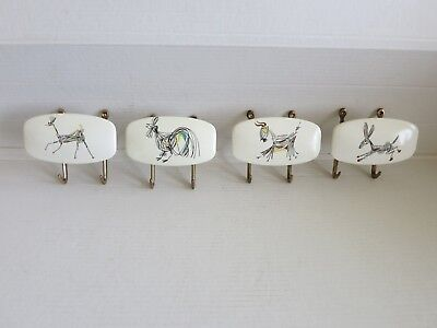 mid century very unique French 4 coat wall hooks. quality plastic & brass hooks