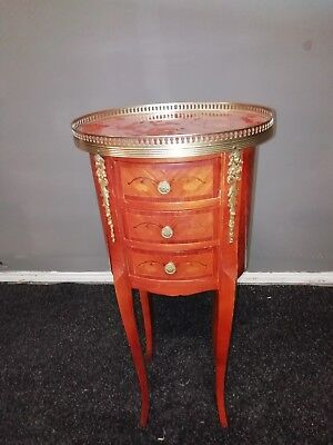 Small French Louis XV style table in marquetry and bronze.