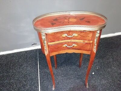 Small French Louis XV style table in marquetry and bronze