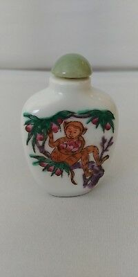 Beautiful hand painted Chinese snuff bottle with dynasty mark on bottom.