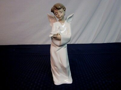 "Nao by Lladro Figurine #1261. ""Protecting Angel"". Issued 1997. Perfect."