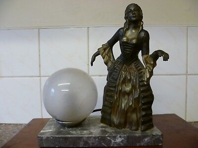 An Antique French Bronze Finish 'crinoline Lady' Table Lamp, On A Marble Base..